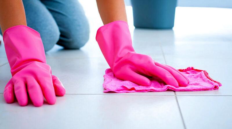 man cleans tiles