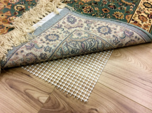 how to stop rugs moving on carpet